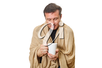 Adult man warms himself with a warm blanket and hot tea