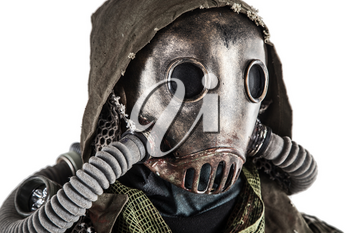 Close up portrait of nuclear post-apocalypse survivor, living underground mutant or creature, skilled stalker wearing rags and armored full-face gas mask or air breathing apparatus, toned shoot