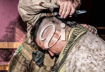 Soldier cuts comrades hair with trimmer. United States marine shaving friends head with clipper in combat conditions. Recruiter preparing for service in military forces by receiving initial haircut