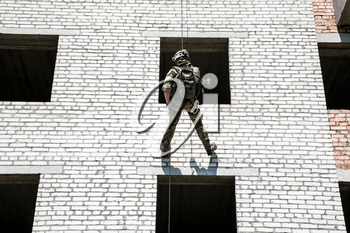 Soldier during assault rappeling exercises with weapons
