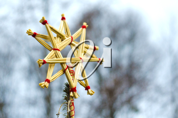Straw star, isolated on blurred background. Christmas tree decoration made of straw.