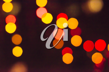 Abstract bokeh blurred color light background. Blur lights for Christmas, party, holiday wallpaper. Defocused lights.