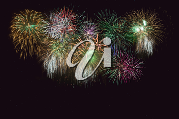 Beautiful celebration golden, green sparkling fireworks.  Independence Day, 4th of July holidays salute. New Year beautiful fireworks. Holidays symbol background.