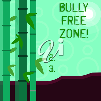 Conceptual hand writing showing Bully Free Zone. Concept meaning creating abuse free school college life Colorful Set of Leafy Bamboo and Moon or Sun with Round Beam