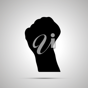 Black silhouette of hand in fist gesture isolated on white