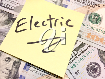 American cash money and yellow paper note with text Electric in black color aerial view