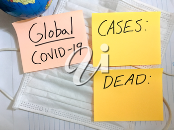 Coronavirus COVID-19 global infection medical cases and deaths. China COVID respiratory disease influenza virus statistics hand written on surgical mask and earth globe background