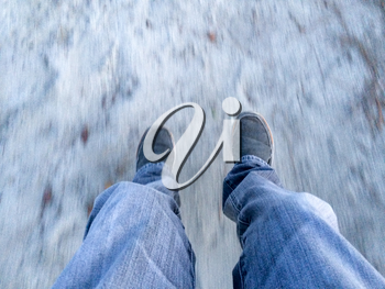 Adult on swing POV to sand over blue jeans and casual shoes