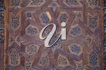 Elaborate decoration of ceiling with carved wooden patterns in Madrasa Bou Inani, Fez, Morocco