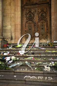LYON-FRANCE NOVEMBER 15, 2015:  Offerings, toughts, flowers and candles on the steps of the town hall at Lyon, France about the terrorist bombing happens in France on 13th november 2015.